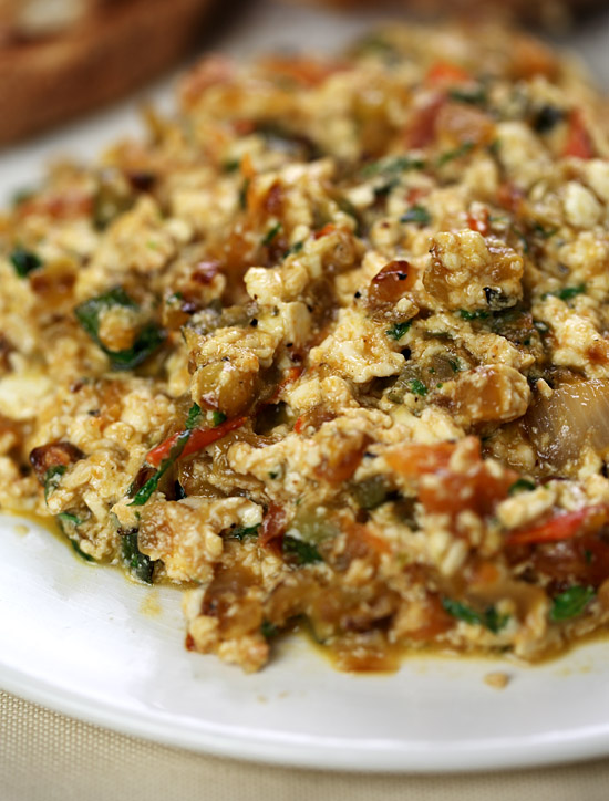 Scrambled tofu with zucchini, tomato and basil